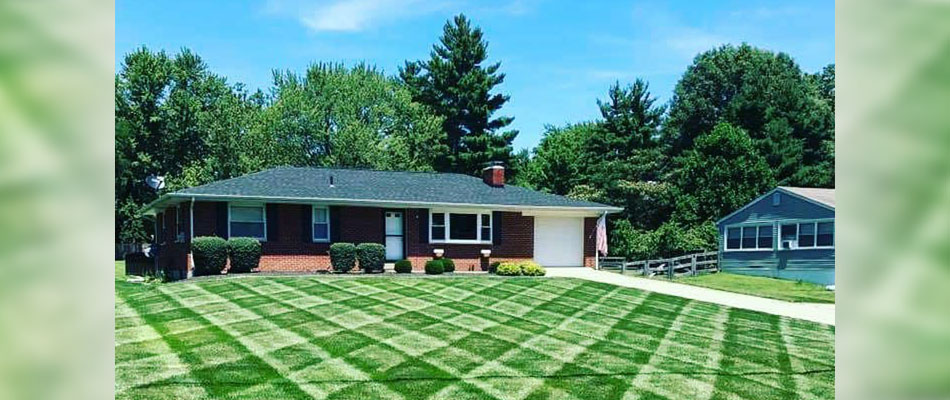 Residential home with a newly mowed lawn with perfectly placed strips.