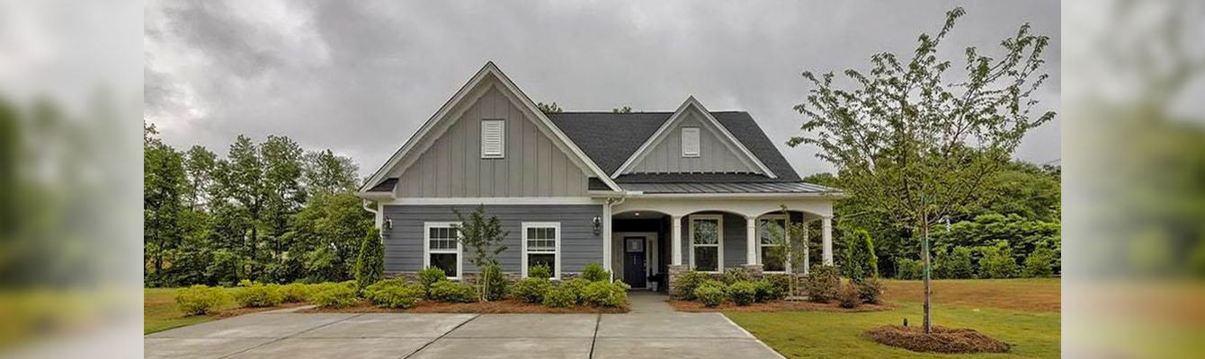 Front view of a home with a beautiful green lawn.