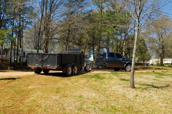 The Boiling Springs truck and trailer are parked on a customers property ready to to trim the trees.